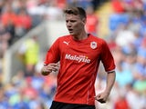 Joe Mason of Cardiff City in action during the Pre Season Friendly match between Cardiff City and Athletic Club de Bilbao at the Cardiff City Stadium on August 10, 2013