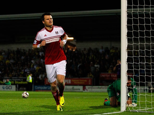John Arne Riise of Fulham celebrates after scoring the winning goal in the penalty shoot-out during the Capital One Cup Second Round match between Burton Albion and Fulham at the Pirelli Stadium on August 27, 2013