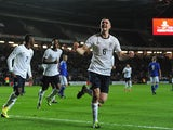 England's Michael Keane celebrates after scoring the opening goal against Finland during their 2015 UEFA European Under 21 Championships Qualifier Group 1 match on November 14, 2013