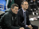 Republic of Ireland's manager Martin O'Neill looks on with assistant manager Roy Keane before the start of the international friendly football match between the Republic of Ireland and Latvia at Aviva Stadium in Dublin on November 15, 2013