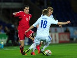 Wales striker Gareth Bale takes on the Finland defence uring the International Friendly match between Wales and Finland at Cardiff City Stadium on November 16, 2013