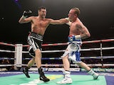 Carl Froch connects with George Groves during their IBF & WBA World Super Middleweight Title fight on November 23, 2013