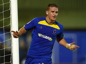 League Two roundup: Dons complete late comeback