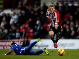 George Saville of Brentford breaks away from the challenge of Byron Moore of Crewe during the Sky Bet League One match between Brentford and Crewe Alexandra at Griffin Park on November 16, 2013