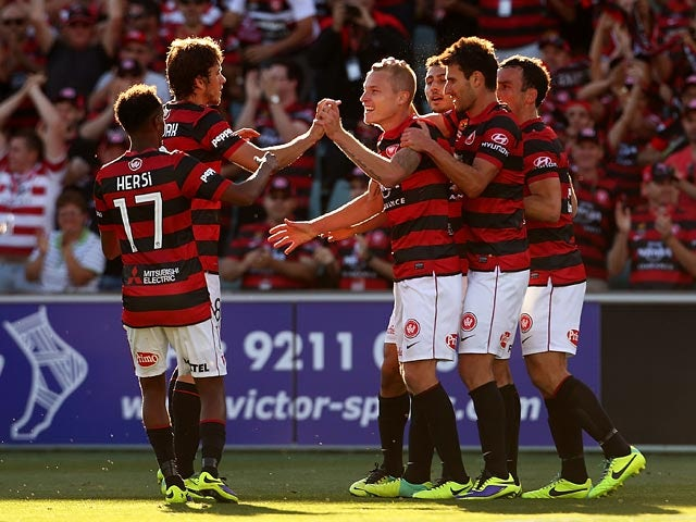 Western Sydney's Aaron Mooy celebrates with teammates after scoring the equaliser against Melbourne Heart during their A-League match on December 7, 2013