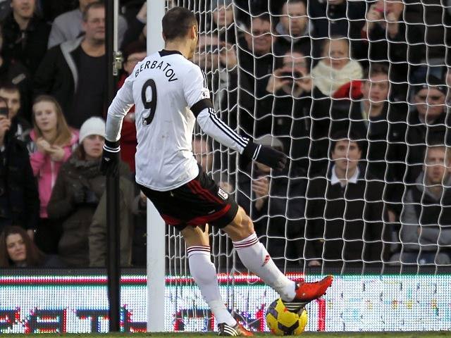 Fulham's Dimitar Berbatov scores his team's second goal via the penalty spot against Aston Villa during their Premier League match on December 8, 2013
