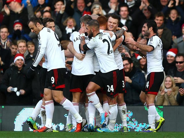 Fulham's Steve Sidwell celebrates with teammates after scoring the opening goal against Aston Villa during their Premier League match on December 8, 2013