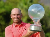 Thomas Bjorn with the trophy after winning the Nedbank Golf Challenge on December 8, 2013