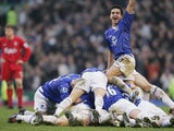 Everton players celebrate Lee Carsley's winning goal during the Merseyside derby on December 11, 2004.
