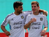 Lionel Messi and Sergio Aguero embrace during an Argentina training session on September 06, 2013.