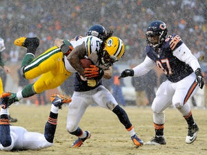 Running back Eddie Lacy of the Green Bay Packers carries the ball in the first quarter against the Chicago Bears during a game at Soldier Field on December 29, 2013