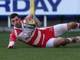 Gloucester's Jonny May dives over to score a try against London Irish during their Aviva Premiership match on December 29, 2013