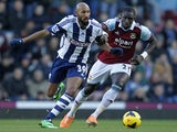 West Bromwich Albion's French striker Nicolas Anelka vies with West Ham United's Senegalese midfielder Mohamed Diame during the English Premier League football match on December 28, 2013