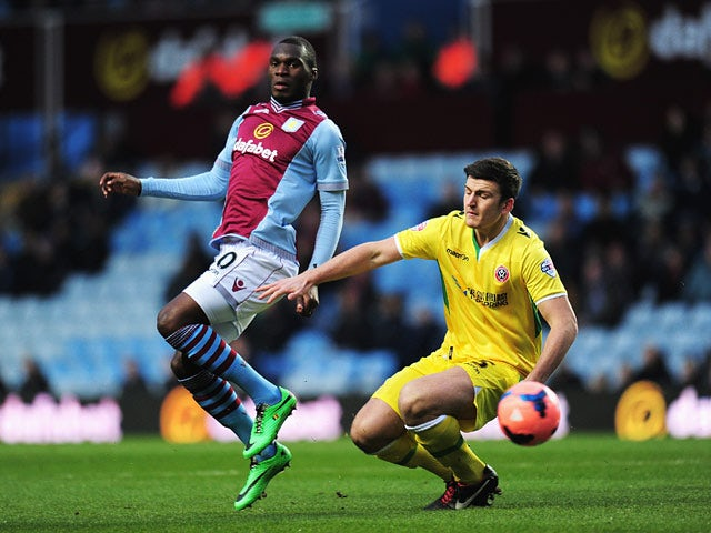Aston Villa's Christian Benteke and Sheffield United's Harry Maguire in action during their FA Cup third round match on January 4, 2013