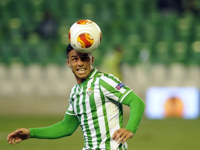 Betis' forward Ruben Castro heads the ball past Rijeka's defender Niko Datkovic during the UEFA Europa League Group I football match Real Betis Balompie vs HNK Rijeka at the Benito Villamarin stadium in Sevilla on December 12, 2013