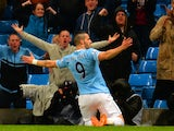 Alvaro Negredo of Manchester City celebrates scoring the opening goal during the Capital One Cup Semi-Final first leg match between against West Ham United on January 8, 2014