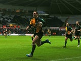 Northampton Saints' George North sprints ahead to score a try against Ospreys during their Heineken Cup match on January 12, 2014