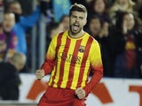 Barcelona's defender Gerard Pique celebrates after scoring during the Spanish league football match Levante UD vs FC Barcelona at the Ciutat de Valencia Stadium in Valencia on January 19, 2014