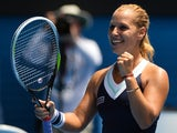 Slovakia's Dominika Cibulkova celebrates after victory in her women's singles match against Russia's Maria Sharapova on day eight of the 2014 Australian Open tennis tournament in Melbourne on January 20, 2014