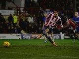 Marcello Trotta scores a goal for Brentford during the Sky Bet League One match between Brentford and Gillingham at Griffin Park on January 24, 2014