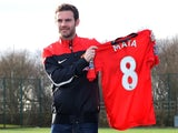 Juan Mata poses with his new #8 Manchester United shirt on January 27, 2014