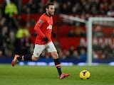 Manchester United's Spanish midfielder Juan Mata controls the ball during the English Premier League football match between Manchester United and Cardiff City at Old Trafford in Manchester, northwest England, on January 28, 2014