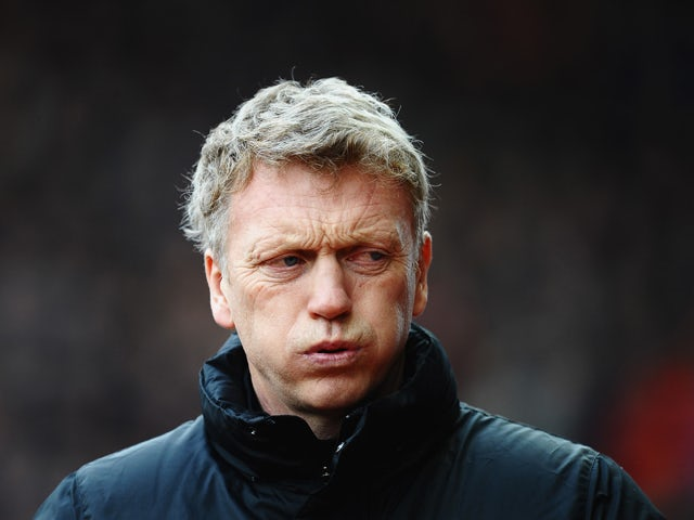 David Moyes, manager of Manchester United walks out for the Barclays Premier League match between Stoke City and Manchester United at Britannia Stadium on February 1, 2014