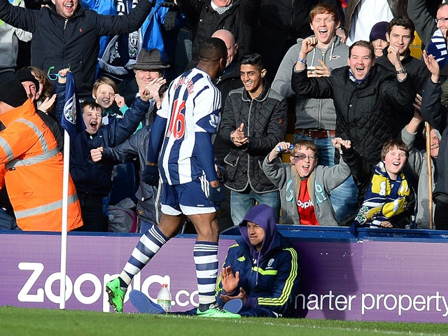 West Bromwich Albion's Nigerian forward Victor Anichebe celebrates after scoring the equalising goal during the English Premier League football match between West Bromwich Albion and Liverpool at The Hawthorns in West Bromwich, central England, on Februar