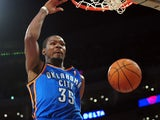 Kevin Durant of the Oklahoma City Thunder scores off a slam dunk against the Los Angeles Lakers during their NBA game at Staples Center on February 13, 2014
