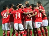 Benfica players celebrates the opening goal against Paok Thessaloniki during their Europa League match on February 20, 2014