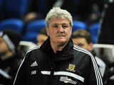 Hull City's English manager Steve Bruce is pictured before the start of the English FA Cup fifth round football match between Brighton & Hove Albion and Hull City at The American Express Community Stadium in Brighton, southern England on February 17, 2014