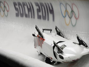Canada-3 four-man bobsleigh, pilot Justin Kripps, pushman Jesse Lumsden, pushman Cody Sorensen and brakeman Ben Coakwell crash in the Bobsleigh Four-man Heat 2 at the Sanki Sliding Center during the Sochi Winter Olympics on February 22, 2014