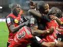 Guingamp's French forward Mustapha Yatabare is congratulated by teammates after scoring during the French L1 football match Guingamp vs Nice on February 22, 2014