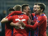 Viktoria Plzen's Stanislav Tecl is congratulated by teammates after scoring against Shakhtar Donetsk during their Europa League match on February 20, 2014