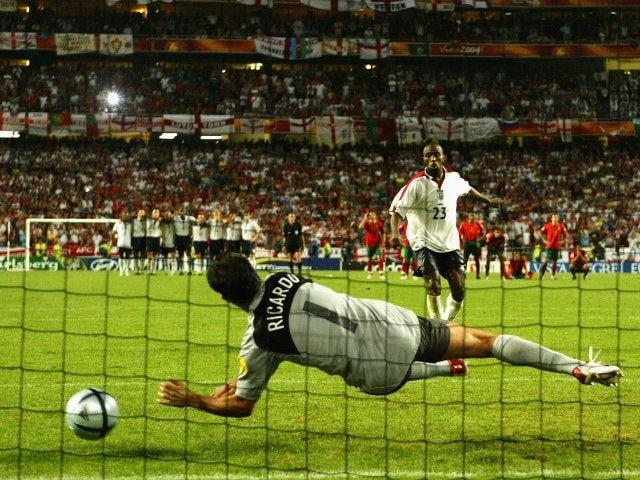 England's Darius Vassell has his penalty saved by Portugal goalkeeper Ricardo on June 24, 2004.