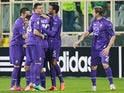 Fiorentina's Josip Ilicic celebrates with teammates after scoring the opening goal against Esbjerg during their Europa League match on February 27, 2014