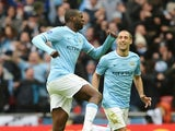Yaya Toure of Manchester City celebrates his goal with Pablo Zabaleta of Manchester City during the Capital One Cup Final between Manchester City and Sunderland at Wembley Stadium on March 2, 2014