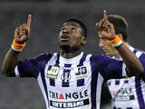 Toulouse's Serge Aurier celebrates after scoring his team's first goal against Reims during their Ligue 1 match on March 8, 2014