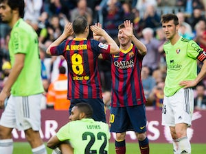 Lionel Messi of FC Barcelona is congratulated by his teammate Andres Iniesta after scoring his team's fourth goal and his goal number 370 for the FC Barcelona becoming the maximum scorer on the history of FC Barcelona during the La Liga match between FC B