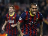 Barcelona's Brazilian defender Dani Alves celebrates after scoring during the UEFA Champions League round of 16 second leg football match FC Barcelona vs Manchester City at the Camp Nou stadium in Barcelona on March 12, 2014