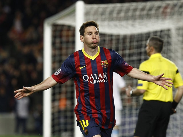 Barcelona's Argentinian forward Lionel Messi celebrates after scoring during the UEFA Champions League round of 16 second leg football match FC Barcelona vs Manchester City at the Camp Nou stadium in Barcelona on March 12, 2014