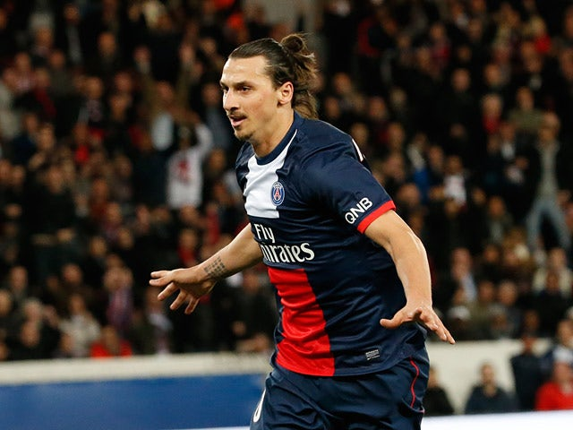 PSG's Zlatan Ibrahimovic celebrates after scoring the opening goal against Saint-Etienne during the Ligue 1 match on March 16, 2014