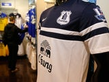 An Everton badge is seen on a replica playing shirt inside the club shop before the Barclays Premier League match between Everton and West Ham at Goodison Park on March 1, 2014
