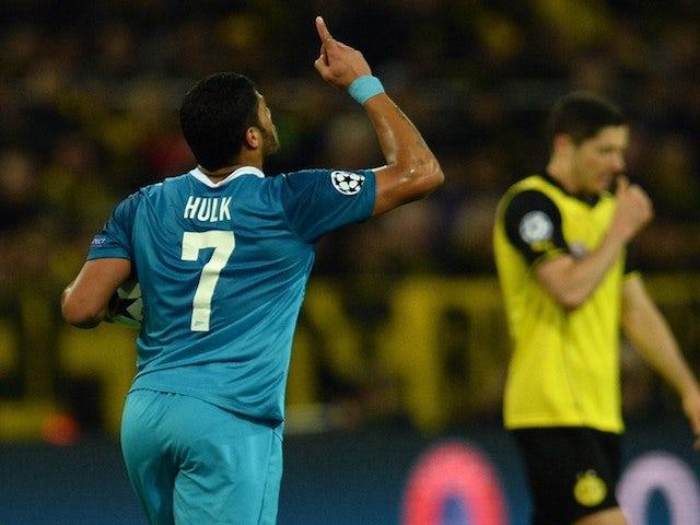 Hulk celebrates after scoring 1-0 during the last 16 second-leg UEFA Champions League football match Borussia Dortmund vs Zenit St Petersburg on March 19, 2014