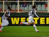 Juventus' midfielder Andrea Pirlo celebrates after scoring a free kick during UEFA Europa League round of 16, second-leg football match Fiorentina vs Juventus at Artemio Franchi stadium in Florence on Marc 20, 2014