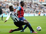 Mapou Yanga-Mbiwa (L) of Newcastle United tackles Yannick Bolasie of Crystal Palace (R) during the Barclays Premier League match on March 22, 2014