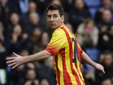 Barcelona's Argentinian forward Lionel Messi celebrates after scoring during the Spanish league football match against RCD Espanyol on March 29, 2014