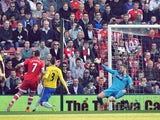 Southampton's English striker Rickie Lambert scores their second goal past Newcastle United's English goalkeeper Rob Elliot (R) during the English Premier League football match between Southampton and Newcastle United at St Mary's Stadium in Southampton,
