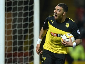 Troy Deeney of Watford celebrates scoring his team's second goal during the Sky Bet Championship match between Watford and Blackburn Rovers at Vicarage Road on March 25, 2014