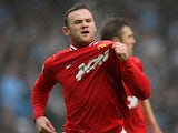 Wayne Rooney celebrates scoring against Manchester City on January 08, 2012.